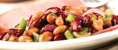 This scrumptious bean salad combines kidney beans, pinto beans, sliced red onion and diced green pepper dressed with a flavorful combination of Pace® Picante Sauce, cilantro, oil and vinegar.