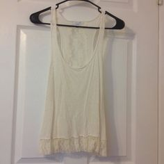 Cream colored lace back tank. Super cute lace back tank.  GUC.  Worn once. Delias Tops Tank Tops