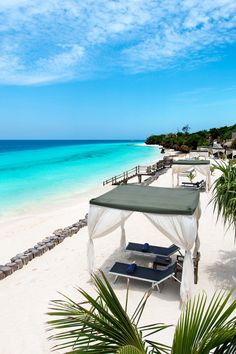 A short walk away, guests have access to reserved seating and butlers on the white sand beach. #Jetsetter