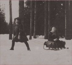 Maria & Olga, 1908 - of course Maria would be the one pulling the sled!
