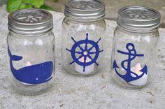 Nautical Mason Jar Lantern Tutorial - whale, wheel and anchor Mason Jar Lanterns, Mason Jars, Nautical Centerpiece, Anchor Baby Showers, Deco Mesh Garland, Nautical Party, Nautical Anchor, Jar Art, Canning Jars