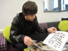 Jake looking through a magazine