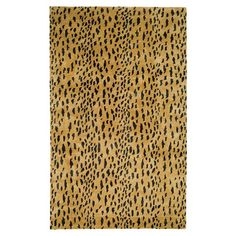 Anchor your dining set or living room seating group in bold style with this animal-print rug, hand-tufted from wool for traditional appeal.