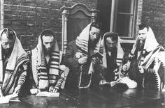 German propaganda photo of Jews at prayer in the Lodz ghetto.