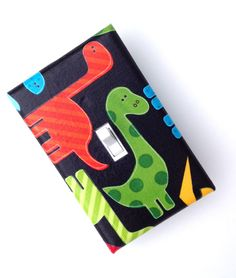 Dinosaur Light Switch Plate Cover / Baby Boy Nursery / Kids Room / Red, Green, Blue / Ann Kelle Urban Zoologie Dinos Bright Primary. $8.00, via Etsy.