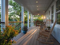 Opened up and defined by a unique stainless steel and Ipe wood railing system, the porch is furnished with durable acacia wood rockers and synthetic-wicker chairs. Home Porch, Diy Porch, Porch Ideas, Outdoor Spaces, Outdoor Living, Outdoor Decor, Wood Railing, Cable Railing, Railings