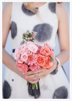 bright florals to contrast black and white wedding color palette. Also, check out that awesome mani!