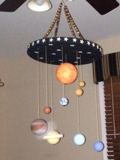 Solar System Mobile made out of smooth styrofoam balls.