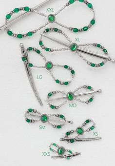 Lilla Rose Inc - Elegant Emerald Dream is lovely with a stone set of emerald green surrounded with a classy celtic frame. The adorning arrangement fancies stylish etched metal and green fire-polished beads.