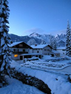 Garmisch-Partenkirchen, Bavaria Germany- love the single glowing light in the snowy dusk
