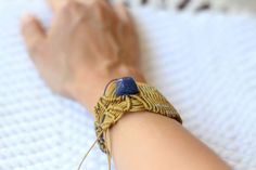 Gold, silver and blue macramé bracelet blue and silver beads