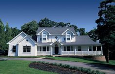 Large 5 bedroom farmhouse with wrap around covered porch.  Farm House Plan # 321054.