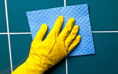 Make your own grout cleaner with 1 cup of dish soap and 1 cup of heated white vinegar