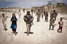 Patrolling with children near Bagram.