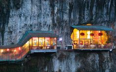 There are few restaurants with a location as striking as Fangweng in China's Hubei Province, which looks as though it is clinging for dear life to the cliff face. Most of the tables are inside a natural cave, while a few lucky diners can sit on the terrace and watch the Yangtze River flow by, hundreds of feet below.