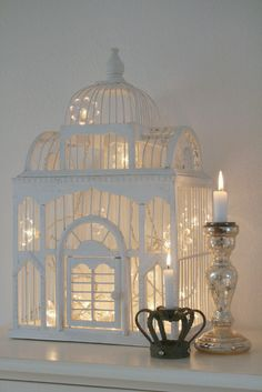 White Birdcage with lights inside, how sweet for a gorgeous take on a night-light.