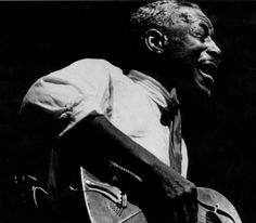 Son House, legendary '30s bluesman who knew Charley Patton and Robert Johnson before Johnson could even hold an audience.  House had stopped performing for 30 years before being coaxed back to stage late in his life.