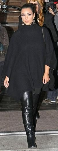 Who made Kim Kardashian's jewelry, turtle neck cape, black thigh high flat boots and black purse that she wore in New York? Shoes – Stuart Weitzman  Sweater – Rachel Pally Poncho  Earrings – Belle Noel  Shoes – Chanel