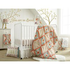 """Babies R Us Exclusive. The Cassia Nursery Collection features soft brushed fabric with a lovely pin tucking feature on the quilt and beautiful boho pattern with metallic gold accents. The 5 Piece Crib Bedding Set includes a Quilt, 100% Cotton Crib Fitted Sheet, Lace Dust Ruffle, Diaper Stacker and metallic gold Wall Decals with the phrase """"You are so loved"""" featuring large silhouette trees.<br> <br>The Levtex Baby Cassia 5 Piece Crib Bedding Set Features:<br><ul><li>With 5 Piece Crib…"""