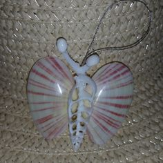 This Seashell Butterfly is handmade here at Sea Things. This Butterfly is all Natural in color. The Wings are polished or Glittered. She is really very pretty and creative with Coral Antennas and each Seashell Ornaments, Seashell Art, Seashell Crafts, Beach Crafts, Seashell Decorations, Seashell Jewelry, Handmade Ornaments, Shells And Sand, Sea Shells