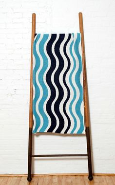 """Coastal Wave stripes alterating in off-white, marine blue and aqua make this new knit throw a cheerful addition to your beach cottage with a hint of surf chic appeal.  A delightful warm 50"""" x 60"""" warm throw accent for your home, or to keep with your picnic basket for afternoons at the shore!"""