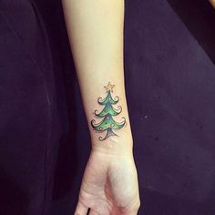 Spread holiday cheer all year with this Christmas tree tatt.