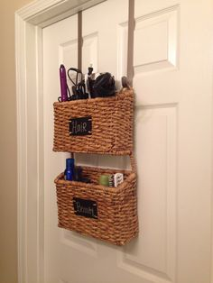 Garden basket on wreath hangers for cute and efficient bathroom storage.
