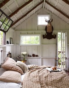 {white rustic modern bedroom} I like how the window seems to slide up using ceiling space instead of wall space