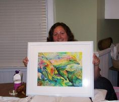 """Here is Debbie's daughter,with a nicely framed print of """"Dolphin Play"""""""