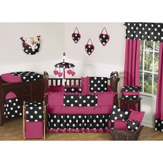 Complete your baby's nursery with this nine-piece baby crib bedding set. Perfect for baby girls, this pink-and-black polka-dot set includes everything you need to complete your little one's room, including pillows, valances, and a diaper stacker.
