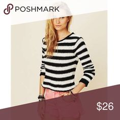 """Free People Beach knitted sweater Clack and white striped sweater from their beach collection• gently used• slight fading• it's a bit on the shorter """"cropped"""" style• bust 18"""" length 20.5"""" •84% cotton 16% rayon Free People Sweaters"""
