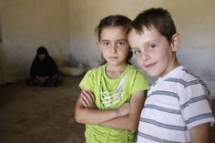 Two young Syrian #refugees in a collective shelter in #Lebanon. Programmes for the refugees are being affected by funding shortages. © UNHCR/S.Malkawi