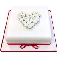 This simple and elegant anniversary cake would be a great addition at any anniversary party.  Decorated with small elegant red roses, this cake is one of our most romantic.  It would also makes a lovely engagement cake, and the colours can all be changed to represent the appropriate anniversary, be it gold for a golden wedding or silver for a silver wedding!  Choose from vanilla, chocolate or red velvet sponge as well as our fun extras!
