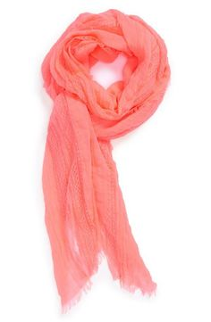 Lightweight coral scarf for spring nights.