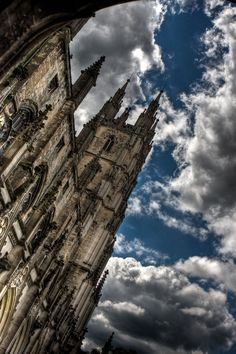 Awesome building angle. With the clouds it looks like there's movement. Canterbury Cathedral