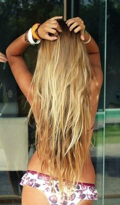 Sunkissed hair...Love the highlighted ombre thing going on with her hair
