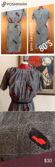 Vintage Dress: An 80's twist on a 40's classic Beautiful dress to make you look and feel like an old movie star. Small shoulder pads and a gathered waist to flatter. Button closure in back. Great for work to night. Vintage Dresses