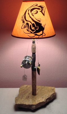 What a unique piece this is! The artwork on this shade is just spectacular! | Reel Lamps | www.reellamps.com 618-521-5302 stevensfishingllc... | #ReelLamps #SouthernIllinois #Fishing #Decor #Gift #Custom #Lamp #Reel #Present #FishingRod #Bait #InteriorDesign #Interior #HuntingLodge #Lodge #FishingLodge #Anniversary #FathersDay #Birthday