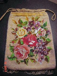 http://forums.vintagefashionguild.org/threads/rare-beaded-bags-added-pics-info.17354/