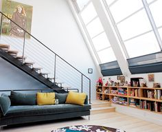 When a kitchen renovation led to a house-wide overhaul, a San Francisco family installed a slanted bank of windows to let light flood the home's interior. Photo by Leslie Williamson.  Photo by: Leslie Williamson