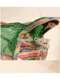 Green ChattapatiGharara with Heavy Embroidery work ofZardozi, SequinsandDabkawork. Multi-colored border with Hand embroidered work.