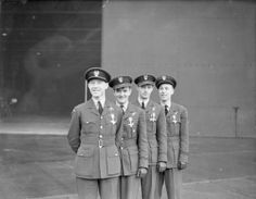 The first four Polish recipients of the Distinguished Flying Cross of No. 303 Fighter Squadron wear their awards after a presentation ceremony by Air Marshal Sholto Douglas at Leconfield, 15 December 1940. Left to right are: Flying Officer Witold Urbanowicz, Pilot Officer Jan Zumbach, Pilot Officer Miroslaw Feric and Flying Officer Zdzislaw Henneberg. CH 1840.