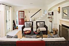 Accent with Red - 108 Living Room Decorating Ideas - Southernliving. Use bright colors and strong patterns to punctuate an otherwise neutral space. The red accessories in this living room add an energetic punch without overwhelming the area.
