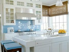 love the blue with the white cabinets and the natural shades