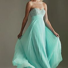 Mint green flowy strapless with diamond on top and whimsical loose material on the bottom. Www.promgirl.com