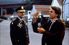 """A trio of stars top the cast of """"The Presidio"""" (1988): Sean Connery, Mark Harmon, and Meg Ryan. Harmon was fresh off his breakout role in """"Summer School"""" (1987) and Meg Ryan would co-star a year later in her famous role opposite Billy Crystal in """"When Harry Met Sally"""" (1989). Harmon is best known for his starring role on the hit TV series """"NCIS"""". This film marked the second and final time that Connery would work with director Peter Hyams. He directed Connery in """"Outland"""" (1981)."""