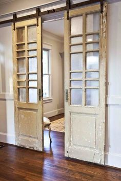 Instead of opting for more traditional barn doors, this blogger hung paneled doors from her local antique auction on sliding hardware. The result is a French doors/barn door mash-up that would make Joanna Gaines proud. Learn more at Cedar Hill Farmhouse.