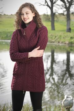 This is a warm and fashionable cable knit sweater coat featuring Celtic knitting throughout. It has a high collar and zip closing section. This cable knit sweater coat is truly Irish in every sense an