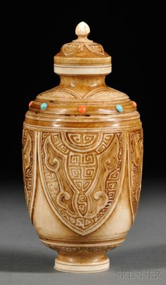Large Ivory Snuff Bottle, China, 20th century, Mughal-style with carved taotie masks, inlaid with turquoise and coral, with stopper, ht. 4 3/4 in