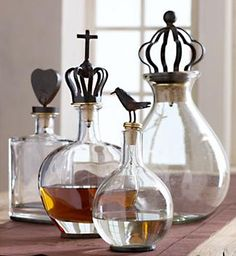 Designer Jan Barboglio decanters with playful stoppers. Crown Decanters with Finials Bottles And Jars, Glass Bottles, Perfume Bottles, Pots, In Vino Veritas, Bottle Stoppers, Deco Design, Wine And Spirits, Bottle Art
